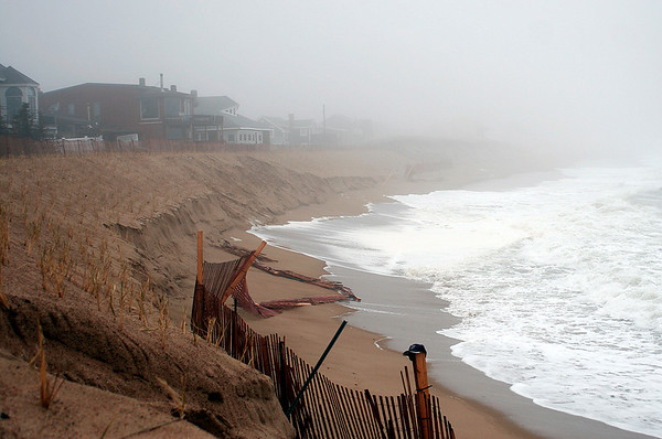 Newbury: The dunes near Plum Island center take another pounding during Tuesday morning's storm. Photo by Ben Laing/Staff Photo