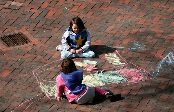Newburyport: Julie Durning, top, and Snowie Mcnabb, bottom, do some chalk drawings  on Inn Street Thursday afternoon. The pair are preschool students at the Newburyport Montessori School. Photo by Ben Laing/Staff Photo
