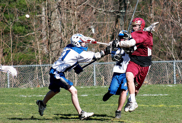 Georgetown: Newburyport's Andrew Sokol (9) fires a shot amid a couple of Georgetown defenders during Wednesday's lacrosse game at Georgetown High. Photo by Ben Laing/Staff Photo