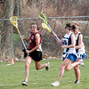 Georgetown: The Clippers Amy Reynolds (20) tries to outmanuever Georgetown's Shannon Hartford (11) during Friday's game in Georgetown. Photo by Ben Laing/Staff Photo