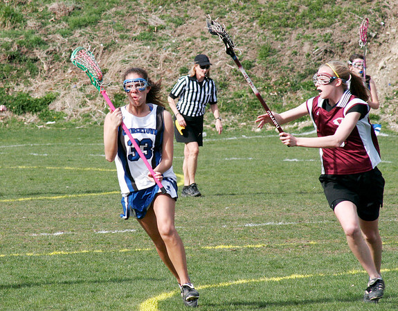 Georgetown: Alyssa Rosenthal (33) of Georgetown brings the ball up the field while evading a Newburyport defender as the Royals hosted the Clippers  Friday afternoon. Photo by Ben Laing/Staff Photo