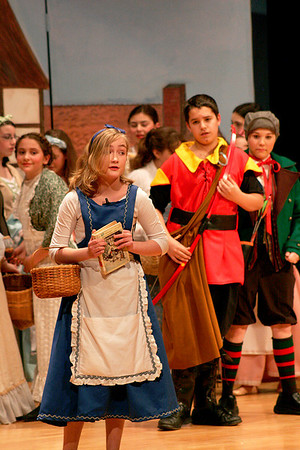 Amesbury: Charlotte Hyde, starring the role of Belle, performs a song with the rest of the cast of Beauty and the Beast 2 at the Amesbury Middle School Thursday night. Photo by Ben Laing/Staff Photo