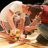 "Amesbury: John Tassinari, right, and Zach Calderwood, left, help assemble part of the set for Amesbury High School's production of ""Little Shop of Horrors"". The two, along with their classmates in Rich Peterson's construction and technology class, designed and built the sets themselves. Photo by Ben Laing/Staff Photo"