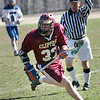 Georgetown: Newburyport's Billy Eiserman (32) brings the ball up the field against the Royals during Wednesday's lacrosse game at Georgetown High. Photo by Ben Laing/Staff Photo