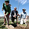 Newburyport: Ian Davis, a sixth grader at the River Valley Charter School, plants a tree with classmates near entrance to the Nock Middle School on Johnson Street. Ian was assisted by Mayor John Moak, center, and Javier Gil, right. Photo by Ben Laing/Staff Photo