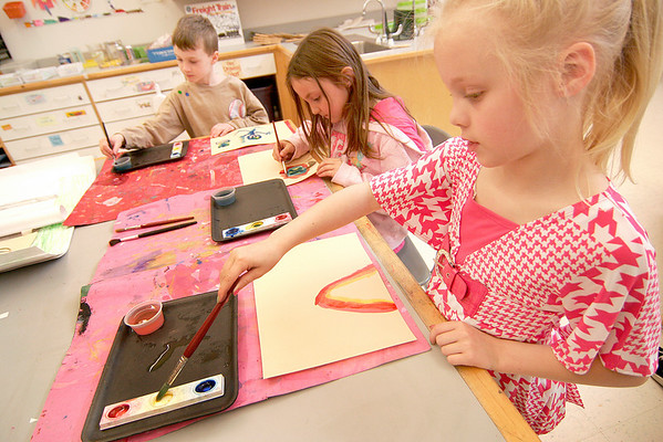 Salisbury: Caitlin Roberge, a second grader at Salisbury Elementary, paints a rainbow in Shannon O'Brien's art class Wednesday afternoon. Photo by Ben Laing/Staff Photo