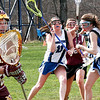 Georgetown: Newburyport goalie, Lily Galzerano (38) watches the ball as the Georgetown's Shannon Hartford (11) tries to sneak across the crease as the Royals hosted the Clippers Friday afternoon. Photo by Ben Laing/Staff Photo