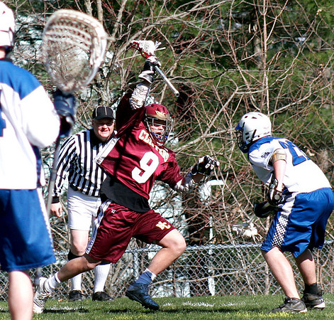 Georgetown: Newburyport's Andrew Sokol (9) tries to work free from a Georgetown defender during Wednesday's lacrosse game in Georgetown. Photo by Ben Laing/Staff Photo