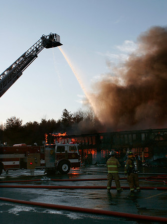 Merrimac: A fire broke out in a shopping plaza on Rt. 110 in Merrimac Friday evening, requiring fire fighters from surrounding areas to lend assistance. Photo by Ben Laing/Staff Photo