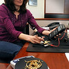 Newburyport:<br /> Lisa A. Rosenthal uses a special sensor to test the purity of gold.<br /> Photo by Bryan Eaton/Newburyport Daily News Tuesday, April 21, 2009