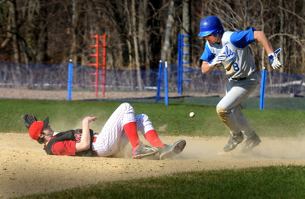 Georgetown:<br /> Georgetown's Anthony Conte rounds second base past Amesbury second baseman Tyler Lay who dove for the ball as it squeaked by yesterday in Georgetown.<br /> Photo by Bryan Eaton/Newburyport Daily News Thursday, April 16, 2009