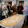 Newburyport:<br /> Members of the Alice Brown Club check out one of the antique wedding dresses in the collection of the Custom House Maritime Museum. From left, Mary Helen McMenamin, Jean Hansen, Peggy Utterback, Sharon Linnea Smith, Cynthia Muir, Laurie Evans Daly and Barbara Bell.<br /> Photo by Bryan Eaton/Newburyport Daily News Tuesday, April 21, 2009
