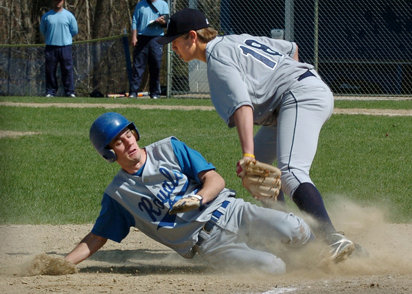 Georgetown: Georgetown's Ryan Browner makes a safe slide into third base under Triton's Blaise Whitman. Bryan Eaton/Staff Photo/Newburyport News  Friday April 24, 2009.