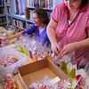 Salisbury: Mary Kirk, left, and Erica Hixon create May Baskets at the Salisbury Public Library to be delivered free to the town's senior citizens on May Day. The Friends of the Library coordinate the effort which is part of a Pike Family bequest to the library. Bryan Eaton/Staff Photo  Newburyport News  Wednesday April 29, 2009.