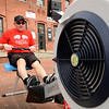 Amesbury: Dave Nock, of Hard Nocks Gym, leads his team working out on rowing machines yesterday in Amesbury's Market Square to coincide with the Boston Marathon. They were helping to raise money for the American Cancer Society's Relay For Life this fall sponsored in part by the Amesbury Police Department.