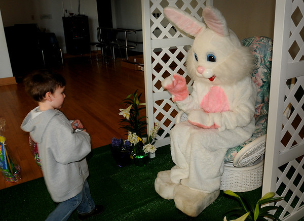 Salisbury:<br /> The Easter Bunny waves to Robert Merenda, 4, as he cautiously approaches Saturday at Salisbury Elementary School. After meeting the bunny and having their pictures taken with him, the children participated in and Easter Egg hunt sponsored by the Salisbury DPW.<br /> Photo by Bryan Eaton/Newburyport Daily News Sunday, April 05, 2009