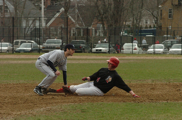 Amesbury: Triton's Mike Cerboni has the ball in hand to tag out Amesbury's Jeff Marston as he attempted to steal second base. Photo by Bryan Eaton/Newburyport News  Tuesday April 7, 2009.