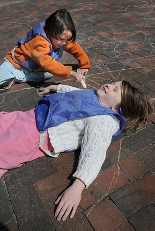 Newburyport: Julie Durning uses chalk to trace around Katie Gootkind, both 5, on Inn Street on Wednesday. The two preschoolers from Newburyport Montessori School were having recess in the afternoon.