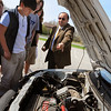 Newburyport: Professor Ziyad Salameh, Director of the Center for Electric Cars and Energy Conversion at University of Massachusetts/Lowell spoke on renewable energy at the Nock Middle School in Newburyport. Here, he shows the front of the car where the batteries are stored. Bryan Eaton/Staff Photo  Newburyport News  Thursday April 30, 2009.