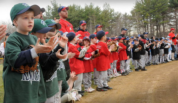 Salisbury: Baseball and softball players applaud coaches and other volunteers who make the season possible during Salisbury's opening day at Lion's Park on Saturday. The children started out with a parade and the first pitch was later thrown by some of the town selectmen.