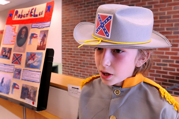 "Amesbury:<br /> Push a button and the ""wax figure"" of Robert E. Lee, a.k.a. Elijah Jackman, 10, comes alive telling the story of the general of the Confederacy at the Cashman School in Amesbury on Thursday. Students chose an historical figure to research then present at the school's annual event.<br /> Photo by Bryan Eaton/Newburyport Daily News Thursday, April 16, 2009"