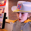 """Amesbury:<br /> Push a button and the """"wax figure"""" of Robert E. Lee, a.k.a. Elijah Jackman, 10, comes alive telling the story of the general of the Confederacy at the Cashman School in Amesbury on Thursday. Students chose an historical figure to research then present at the school's annual event.<br /> Photo by Bryan Eaton/Newburyport Daily News Thursday, April 16, 2009"""