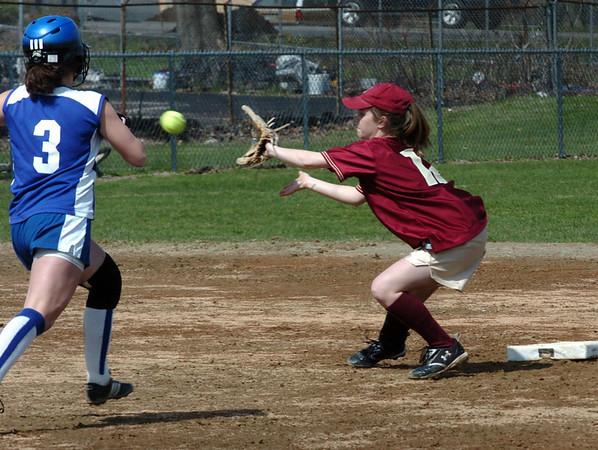 Newburyport:<br /> Newburyport's Rachel Webster eyes the ball to force Georgetown's Amy Cronin out.<br /> Photo by Bryan Eaton/Newburyport Daily News Wednesday, April 22, 2009