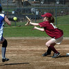 Newburyport:<br /> Newburyport's Rachel Webster eyes the ball to force Georgetown's Amy Cronin out.<br /> Photo by Bryan Eaton/Newburyport Daily News Wednesday, April 22, 2009