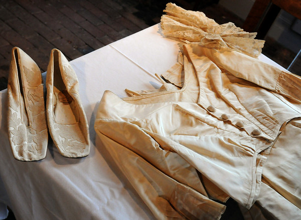 Newburyport:<br /> Mary Helen McMenamin brought her great-grandmother's wedding dress to the Alice Brown Club meeting.<br /> Photo by Bryan Eaton/Newburyport Daily News Tuesday, April 21, 2009