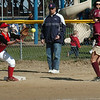Newburyport:<br /> Amesbury first baseman Anna Kate Webber has the ball in hand before Newburyport's Ashley Karelis can make the run.<br /> Photo by Bryan Eaton/Newburyport Daily News Wednesday, April 15, 2009