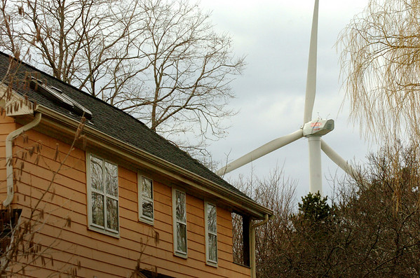 Newburyport:<br /> The wind turbine is clearly in view over home 12 Hill Street.<br /> Photo by Bryan Eaton/Newburyport Daily News Wednesday, April 08, 2009