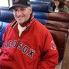 Newburyport:<br /> Jay Sullivan of Salisbury waits for the train to pull out of the Newburyport station to catch the Red Sox season opener yesterday afternoon. Though a big  Red Sox fan, Sullivan, is known more as Salisbury's most ardent Patriots fan.<br /> Photo by Bryan Eaton/Newburyport Daily News Tuesday, April 07, 2009