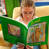 Newburyport:<br /> Kaileigh DeCosta, 9, of Amesbury browses through a David McPhail book at the Book Rack in Newburyport.<br /> Photo by Bryan Eaton/Newburyport Daily News Wednesday, April 22, 2009