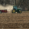 Salisbury:<br /> A worker at Bartlett's Farm in Salisbury spreads organic fertilizer on Tuesday as they and other farms gear up to begin putting their crops into the ground.<br /> Photo by Bryan Eaton/Newburyport Daily News Tuesday, April 14, 2009