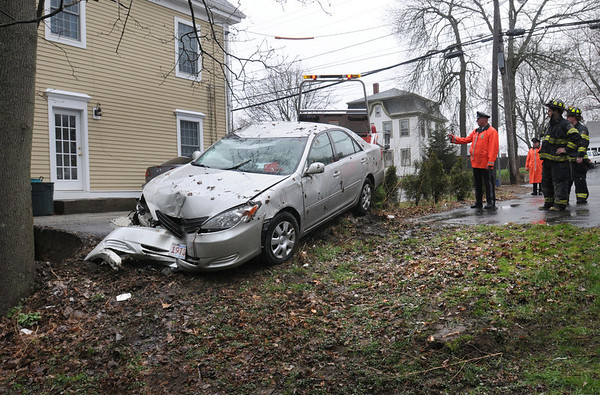 Amesbury:<br /> Two occupants of this car that crashed into this tree on Route 110 in Amesbury near NAPA Auto Parts were taken to the Anna Jaques Hospital to be checked out.<br /> Photo by Bryan Eaton/Newburyport Daily News Wednesday, April 22, 2009