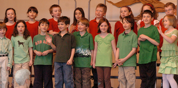 """Merrimac: Second-graders sing """"It's A Small World"""" at the beginning of The International Fair at the Sweetsir School in Merrimac. Parents attended the show which highlighted the world's continents that the children had been learning about."""