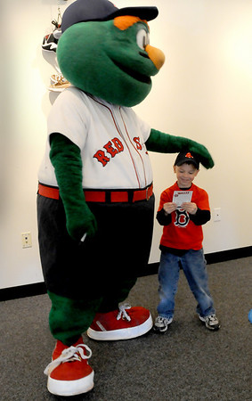 Byfield: Benjamin St. Louis, 4, of Rowley checks out the autograph he got from Wally the Green Monster who visited the Newbury Public Library on Thursday morning. Photo by Bryan Eaton/ Newburyport  Daily  News Thursday, April 23, 2009.