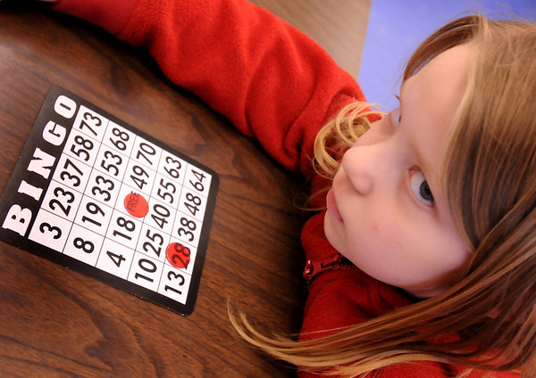 Salisbury:<br /> Noel Murphy, 7, keeps a serious eye and hear focused as numbers are called in a bingo tournament Wednesday afternoon at the Boys and Girls Club. Not only do younger children get use their mind to further acquaint themselves with numbers, they also win prizes.<br /> Photo by Bryan Eaton/Newburyport Daily News Wednesday, April 01, 2009