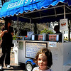 Newburyport:<br /> Spring begins differently for some people, either St. Patrick's Day, March 21 or when the boat docks return to the Merrimack River. But for some, it's when Shirley' Hot Dog Stand opens on Inn Street as it did this week, with Cate Weis, 5, of Newburyport walking away with her first dog of the season.<br /> Photo by Bryan Eaton/Newburyport Daily News Tuesday, April 14, 2009