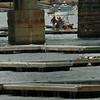 Newburyport: Workers north of the Gillis Bridge on the Merrimack River install docks as work around the boat yards step up as the weather slowly improves. Bryan Eaton Photo/Newburyport News Monday April 20, 2009.