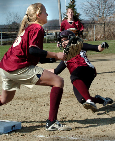 Newburyport:<br /> Gloucester's Alisha Clayton makes it safely to third as Newburyport's Lindsey Tomasz waits for the throw.<br /> Photo by Bryan Eaton/Newburyport Daily News Thursday, April 09, 2009