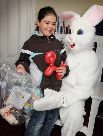 Amesbury:<br /> Lisa Papkey, 10, of Amesbury receives an Easter basket from the Easter Bunny, a.k.a. Provident Bank head Charlie Cullen at Our Neighbor's Table yesterday. Adults received various food products for their Easter dinner.<br /> Photo by Bryan Eaton/Newburyport Daily News Wednesday, April 08, 2009