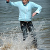 Salisbury:<br /> Breanna Mitchell, 11, of Methuen was playing chicken with the waves at Salisbury Beach on Thursday afternoon and lost. The youngster had a half day at school and headed to the beach with some friends hoping to go to the arcades, which were closed, so headed to the ocean.<br /> Photo by Bryan Eaton/Newburyport Daily News Thursday, April 09, 2009