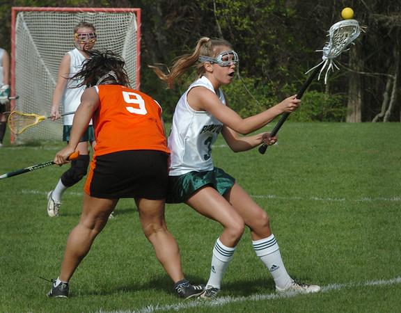 West Newbury: Pentucket's Brianna Yoakum moves past an Ipswich player yesterday at Pipestave Hill. Bryan Eaton/Staff Photo  Newburyport News  Thursday April 30, 2009.