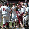 Newburyport:<br /> Newburyport's Matthew Mottola is greeted by teammates as he completes a two-run homer against Triton on Friday.<br /> Photo by Bryan Eaton/Newburyport Daily News Friday, April 10, 2009
