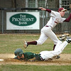 Newburyport:<br /> Clipper's second baseman Ben Tyler makes the catch as Pentucket's Chris Modlish dives to make a safe steal.<br /> Photo by Bryan Eaton/Newburyport Daily News Wednesday, April 08, 2009