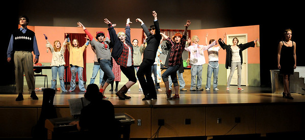 "Amesbury:<br /> The cast of ""The Little Shop of Horrors"" practice on Tuesday afternoon at Amesbury High School. The show is the Drama Club's spring musical presention and will be performed Thursday through Saturday.<br /> Photo by Bryan Eaton/Newburyport Daily News Tuesday, April 14, 2009"