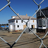 Newburyport:<br /> The construction site behind the Towle Building is gated off as work is still on hold. Photo by Bryan Eaton/Newburyport Daily News Wednesday, April 15, 2009