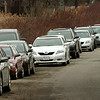 Newburyport:<br /> Cars parked along Boston Way to avoid the $4 parking fee in the MBTA lots.<br /> Photo by Bryan Eaton/Newburyport Daily News Wednesday, April 01, 2009