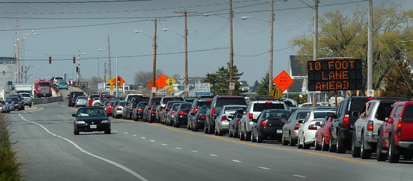 Seabrook: School vacation in New Hampshire, 90-plus degree weather and one lane of traffic over the Hampton Bridge  being repaired, led to a long line of traffic on Ocean Boulevard in Seabrook on Tuesday afternoon. Bryan Eaton/Staff Photo  Newburyport News  Tuesday April 28, 2009.